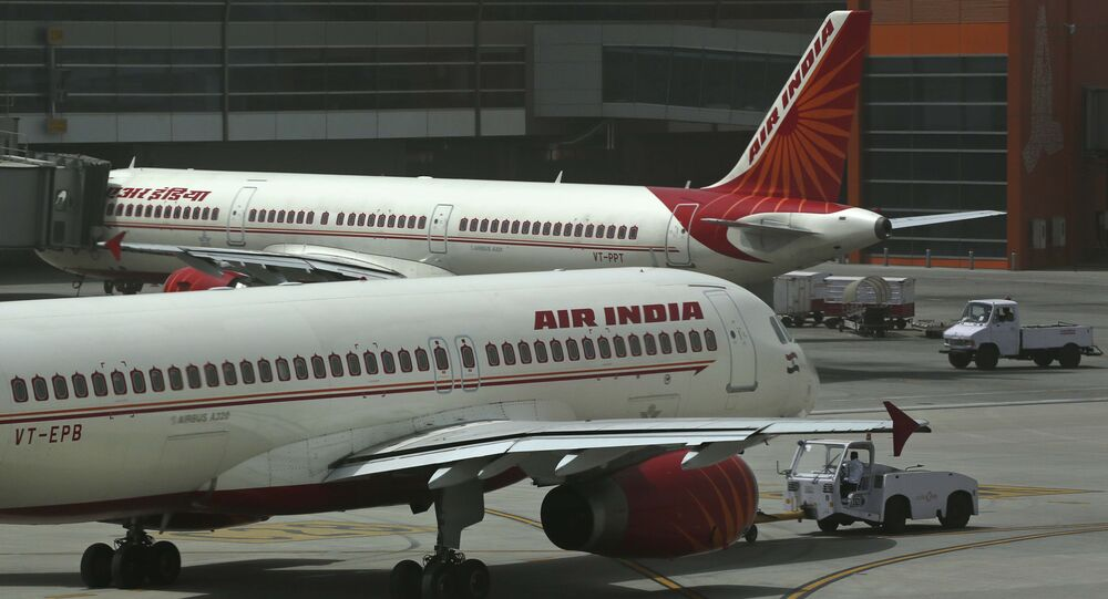 Air India planes are parked on the tarmac at the Terminal 3 of Indira Gandhi International Airport in New Delhi, India, Friday, May 18, 2012