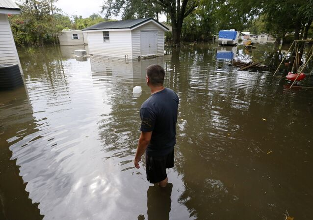 Chris Landaiche looks out to his flooded backyard in Sorrento, Louisiana, U.S., August 21, 2016