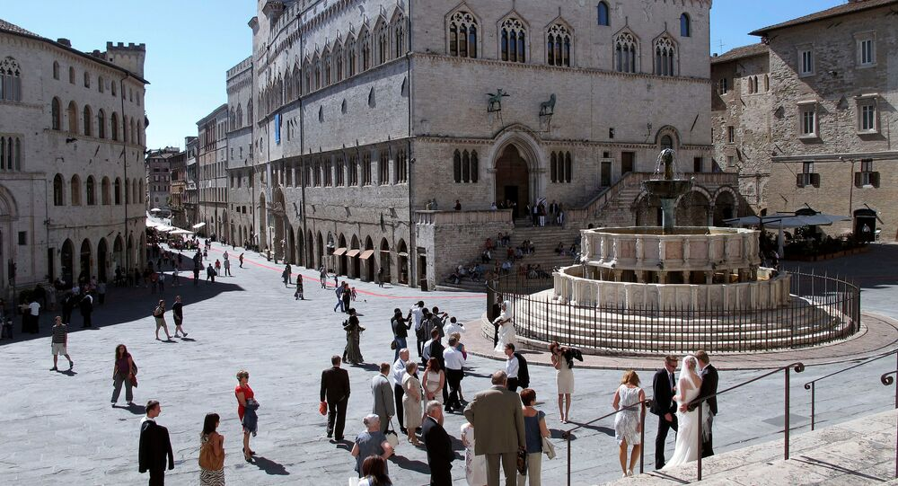 A general view of Priori Palace (C) and Maggiore fountain in downtown Perugia