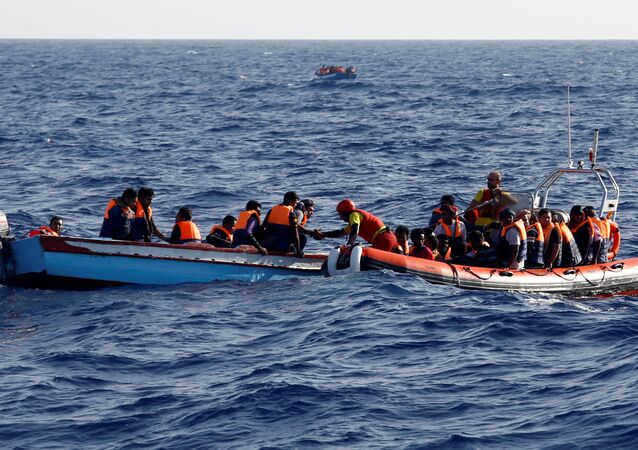 Rescue boat attempts to help refugees at sea