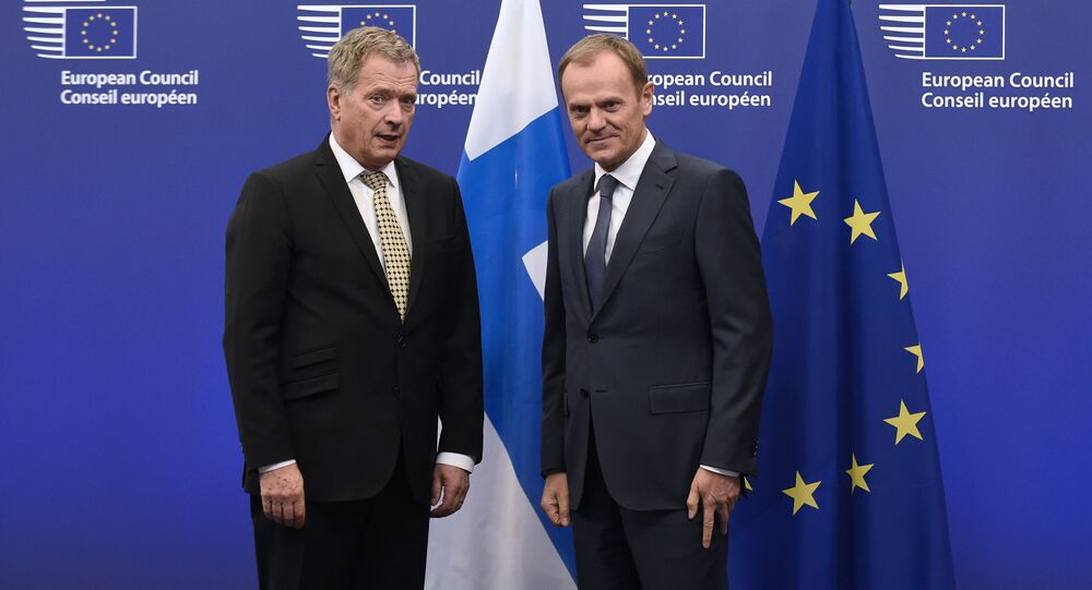 European Union President Donald Tusk (R) poses with Finnish President Sauli Niinisto before their bilateral meeting on January 21, 2015 at the EU Headquarters in Brussels.