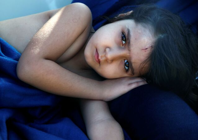 Syrian refugee girl Housaida rests inside the Spanish rescue vessel Astral after being rescued by the Spanish NGO Proactiva off the Libyan coast in the Mediterranean Sea August 18, 2016.