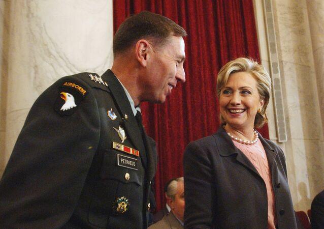 Hillary Rodham Clinton talks with Lt. Gen. David Petraeus on Capitol Hill.