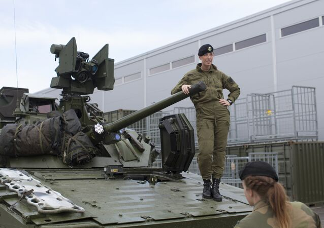 Female soldiers talk next to a CV90 combat vehicle at the armored battalion in Setermoen, northern Norway on August 11, 2016. Norway has become the first NATO member to have compulsory conscription for women as well as men in the army. Recently, the first batch of army recruits joined the ranks in The Armored Battalion in the Norwegian Army located in Setermoen in northern Norway.