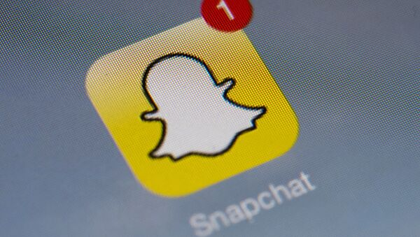 The logo of mobile app Snapchat is displayed on a tablet on January 2, 2014 in Paris. - Sputnik International