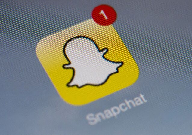 The logo of mobile app Snapchat is displayed on a tablet on 2 January 2014 in Paris.