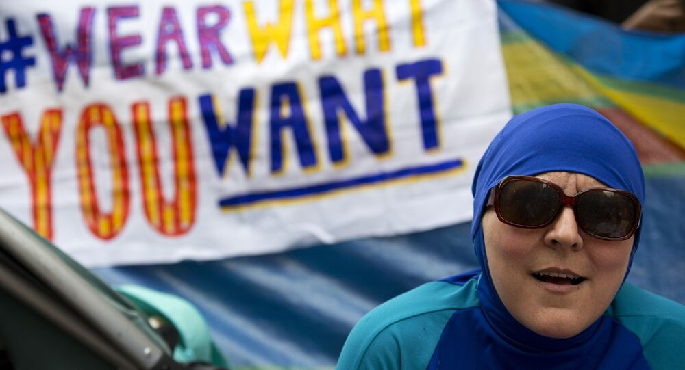 A woman wearing a Burkini joins a protest outside the French Embassy in London on August 25, 2016, during a Wear what you want beach party to demonstrate against the ban on Burkinis on French beaches and to show solidarity with Muslim women.
