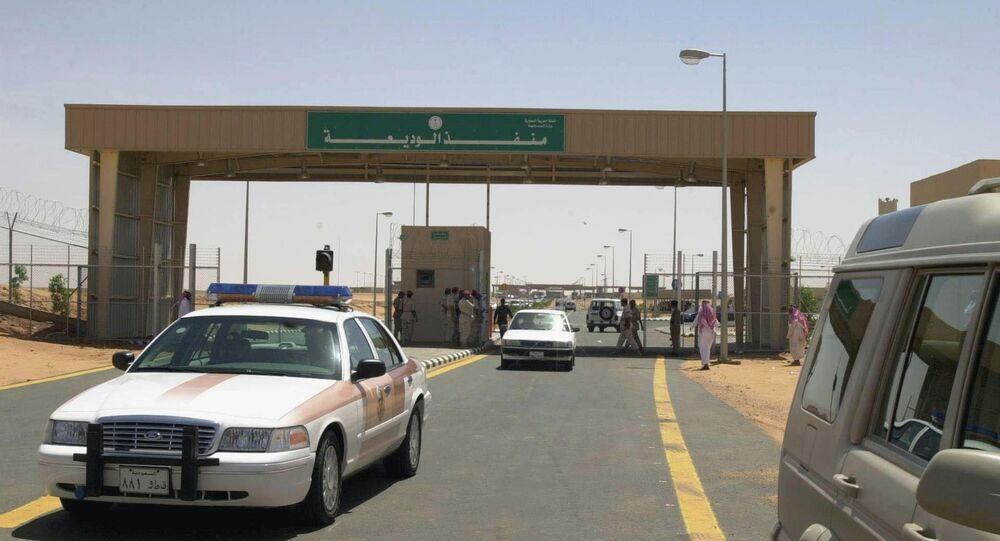 Police and civilian cars cross the new al-Wadia border outpost between Saudi Arabia and Yemen, east of the southern Saudi province of Najran