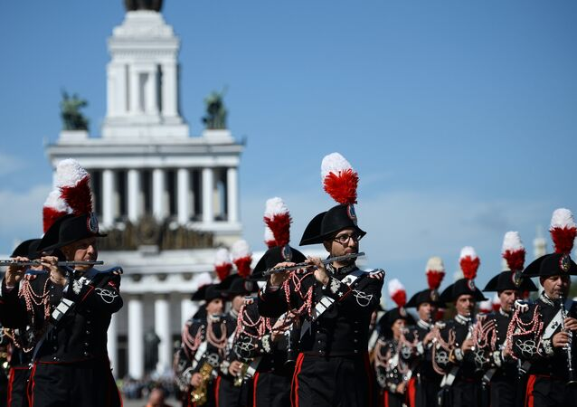 "The participants in the 2016 International Military Music Festival ""Spasskaya Tower"" parade on the VDNKh central alley, Moscow"