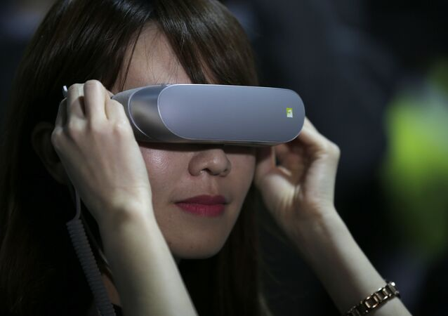 In this Feb. 21. 2016, file photo, a woman uses LG 360 VR glasses during the LG unpacked 2016 event on the eve of the week's Mobile World Congress wireless show, in Barcelona, Spain