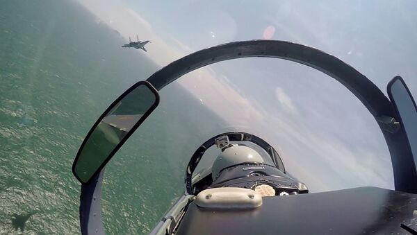 In this undated photo released Saturday, Aug. 6, 2016, by China's Xinhua News Agency, a pair of Chinese fighter jets fly during a patrol over the South China Sea - Sputnik International