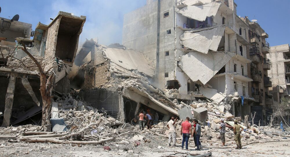 Men inspect a damaged site after double airstrikes on the rebel held Bab al-Nairab neighborhood of Aleppo, Syria, August 27, 2016