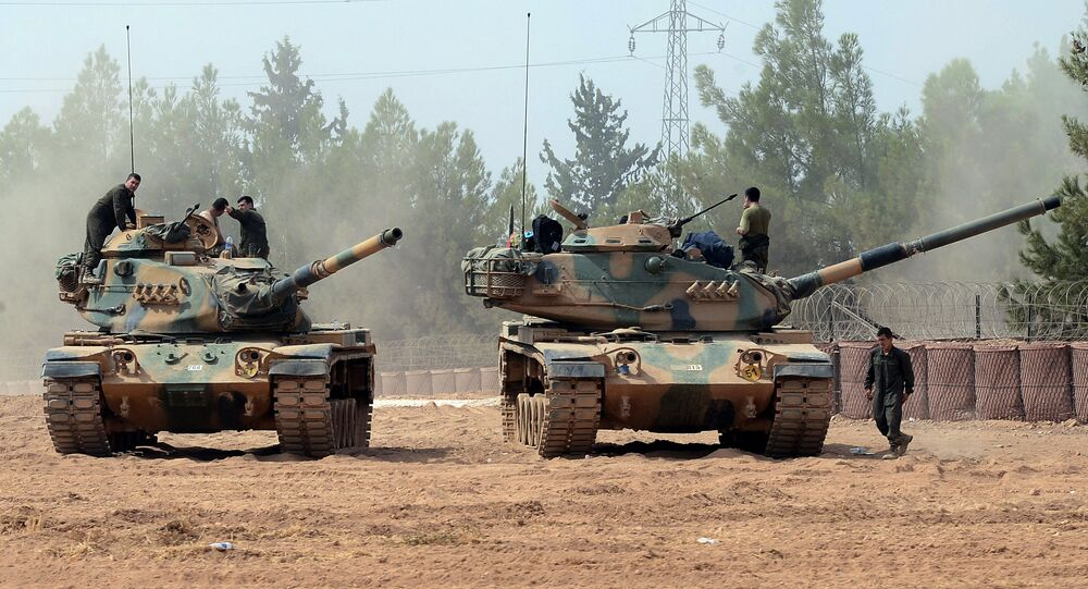 Turkish army tanks are stationed near the Syrian border in Karkamis, Turkey, Thursday, Aug. 25, 2016