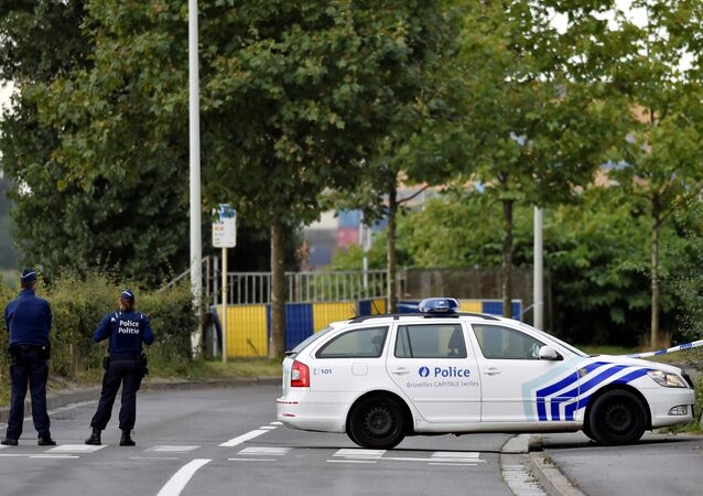 Belgian police officers secure a road near the Belgium's National Institute of Criminology after arsonists set fire to it in Brussels, Belgium August 29, 2016