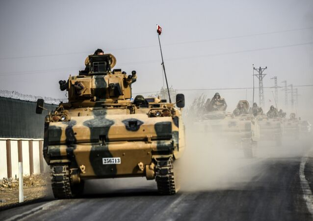 This picture taken around 5 kilometres west from the Turkish Syrian border city of Karkamis in the southern region of Gaziantep, on August 25, 2016 shows Turkish Army tanks driving to the Syrian Turkish border town of Jarabulus