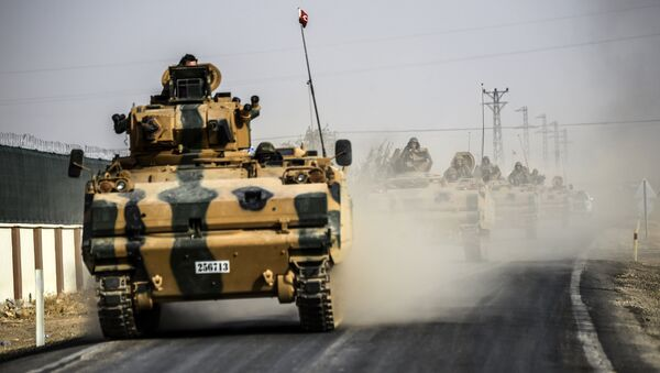 This picture taken around 5 kilometres west from the Turkish Syrian border city of Karkamis in the southern region of Gaziantep, on August 25, 2016 shows Turkish Army tanks driving to the Syrian Turkish border town of Jarabulus - Sputnik International