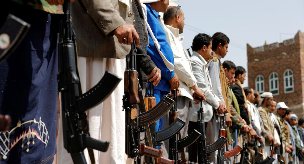Armed men loyal to the Houthi movement hold their weapons as they gather to protest against a Saudi-led coalition air strike that hit a hospital operated by Medecins Sans Frontieres in northern Yemen, in the capital Sanaa August 16, 2016