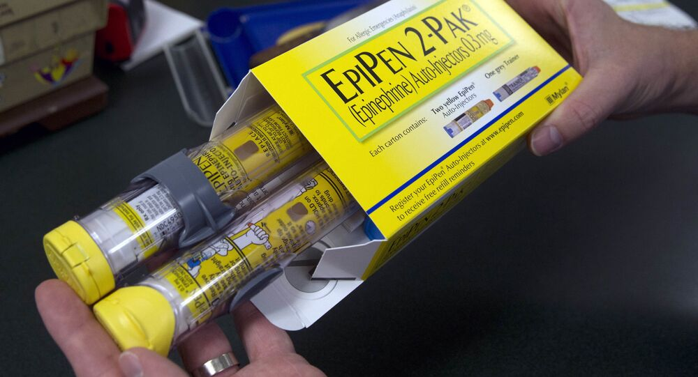 Pharmacist holds a package of EpiPens epinephrine auto-injector, a Mylan product, in Sacramento, Calif. (File)
