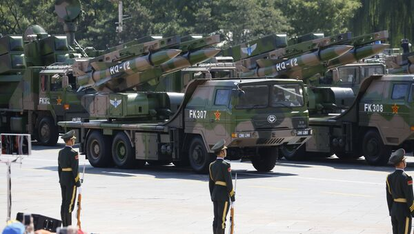 Military vehicles carry HQ-12 surface-to-air missile batteries during a parade commemorating the 70th anniversary of Japan's surrender during World War II. - Sputnik International