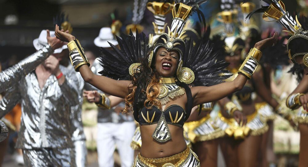 Performers participate in the parade at the Notting Hill Carnival in London, Britain August 29, 2016