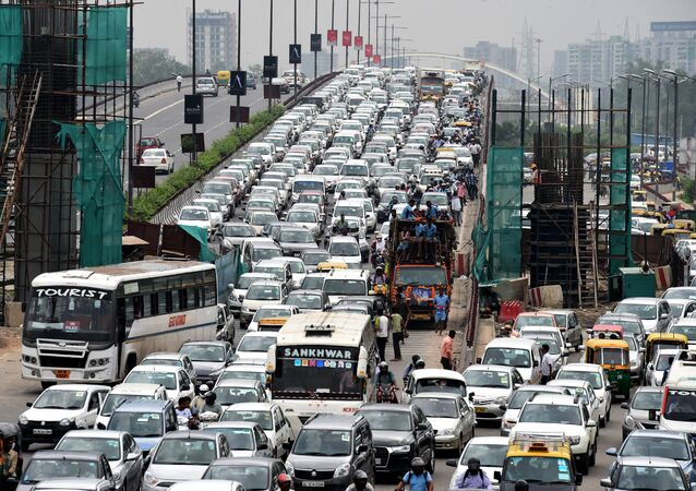 Indian commuters and their vehicles stand in a traffic jam in New Delhi  (File)