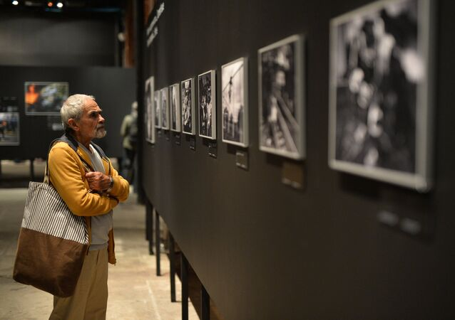 A visitor at the opening of a photo exhibition of the prizewinners in the Andrei Stenin International Press Photo Contest in Moscow. File photo