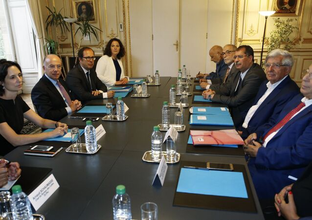 French Interior Minister Bernard Cazeneuve (2ndL), the president of the French Council of the Muslim Faith (CFCM) Anouar Kbibech (3rdR), former French minister Jean-Pierre Chevenement (2ndR) and Paris' Mosque Rector Dalil Boubakeur (R) attend a meeting with representatives of the Muslim community on August 29, 2016 in Paris