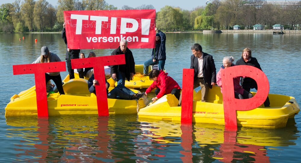 Anti-Trans-Atlantic Trade and Investment Partnership (TTIP) activists sink the lettering TTIP in the Maschsee in Hanover on April 21, 2016 ahead a meeting of leaders of Britain, France, Germany and Italy on April 25, 2016