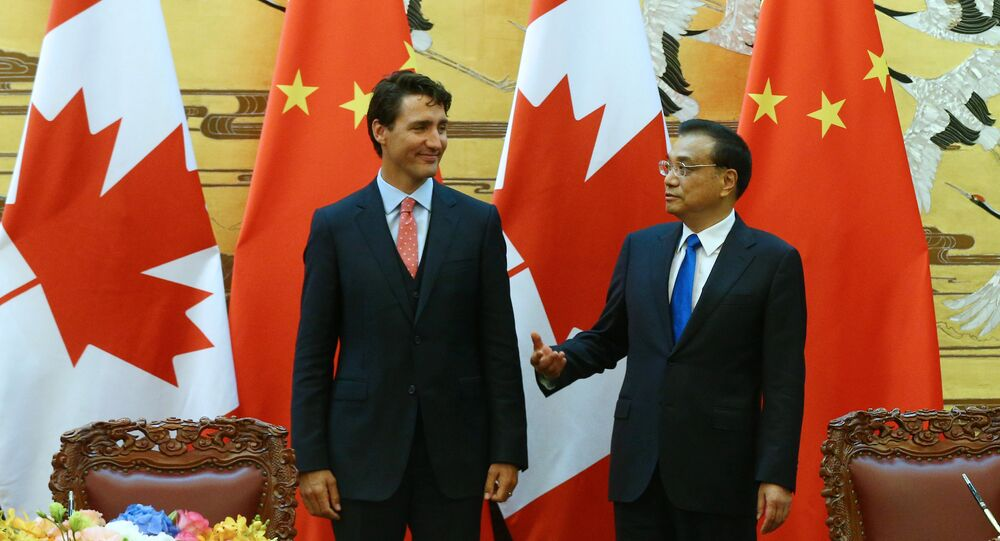 Chinese Premier Li Keqiang (R) and Canadian Premier Justin Trudeau (L) talk as they attend the ceremony of sign agreement documents after a meeting at the Great Hall of the People in Beijing, China, 31 August 2016