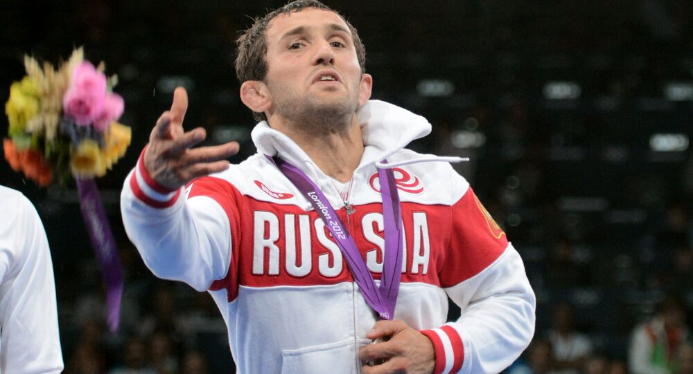 Russia's Besik Kudukhov, silver medalist in men's 60 kg freestyle wrestling at the 30th Summer Olympic Games in London, at the awarding ceremony