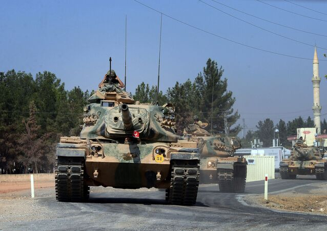 Turkish tanks head to the Syrian border, in Karkamis, Turkey, Wednesday Aug. 31, 2016
