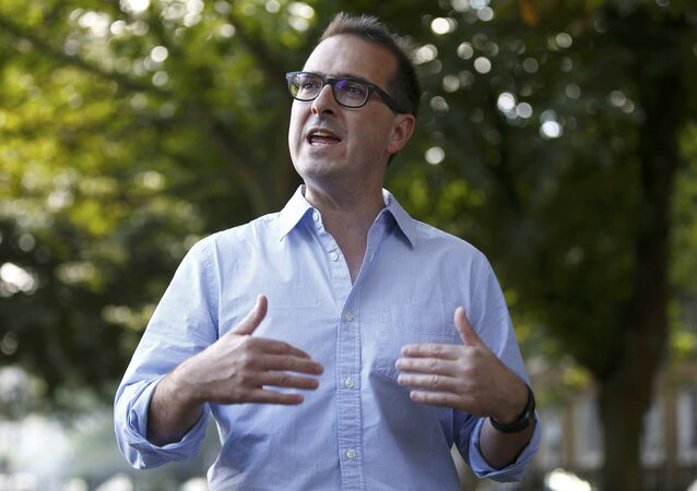 Labour Party leadership contender Owen Smith addresses a group of young Labour supporters during a picnic party in a park in London, Britain August 7, 2016