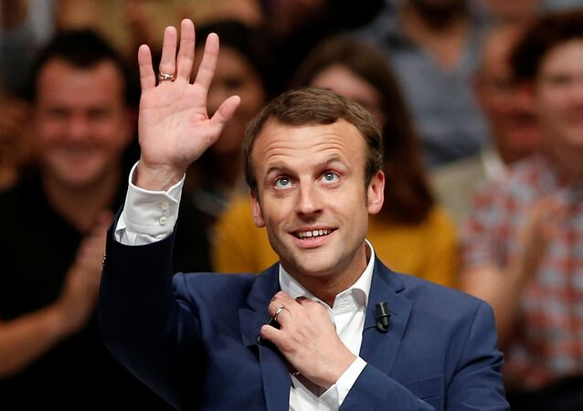 Then-French Economy Minister Emmanuel Macron attends a political rally for his recently launched political movement, En Marche!, or Forward!, in Paris, France, July 12, 2016.