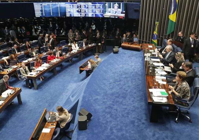 Suspended Brazilian President Dilma Rousseff, first right, speaks during her impeachment trial at the Federal Senate in Brasilia, Brazil, Monday, Aug. 29, 2016