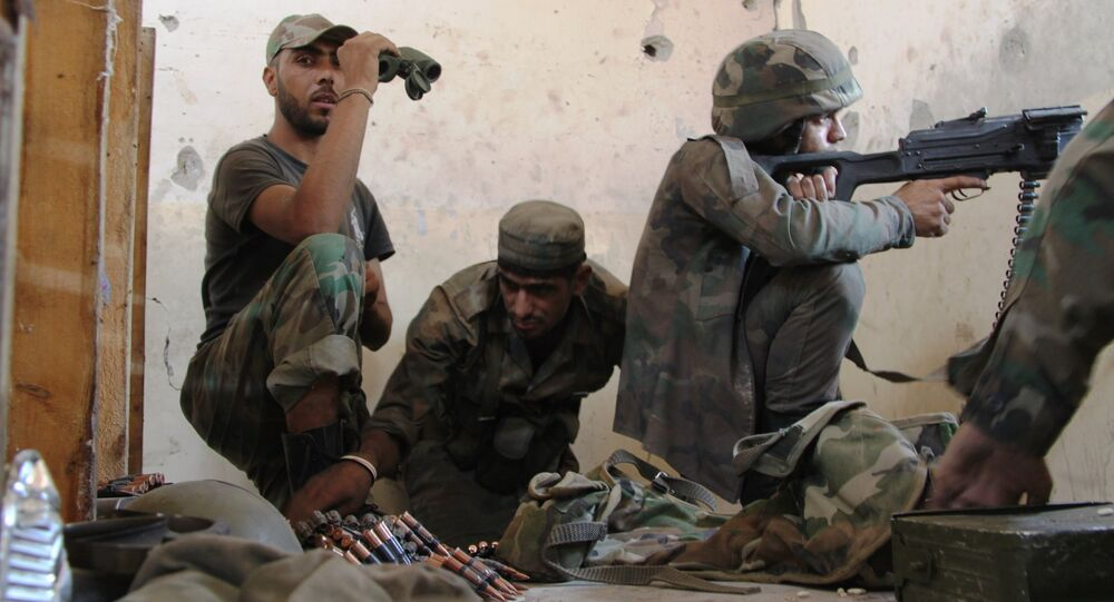 Syrian Army soldier mans his position during the storming of the air force academy in southern Aleppo