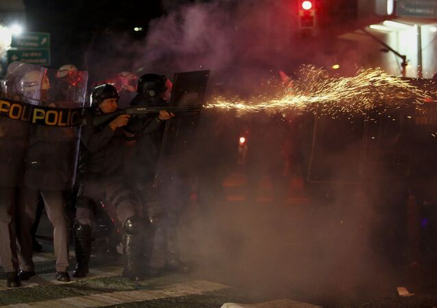 Riot police clash with supporters of Dilma Rousseff as they protest against new Brazilian President Michel Temer at the Paulista Avenue, in Sao Paulo, Brazil on August 31, 2016.