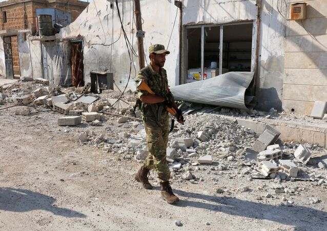 A member of Turkish-backed Free Syrian Army (FSA) patrols in the border town of Jarablus, Syria