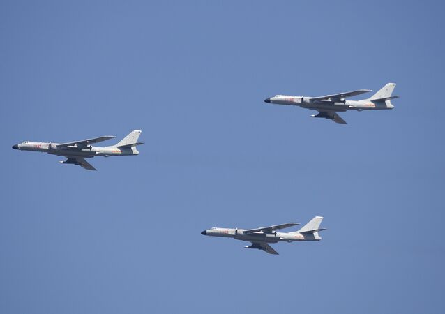 H-6K cruise missile carriers fly in formation during a parade