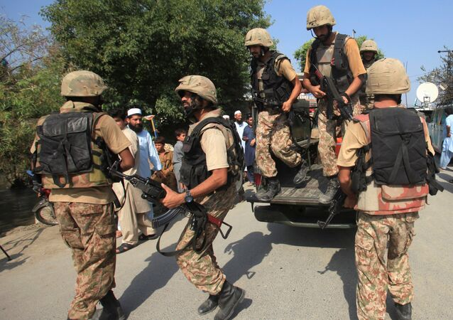 Army soldiers arrive at a street after suicide bombers attacked a Christian neighbourhood in Khyber Agency near Peshawar, Pakistan, September 2, 2016.