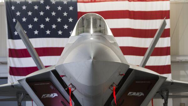 A US Air Force Lockheed Martin F-22 Raptor stealth fighter aircraft is parked inside a hangar - Sputnik International