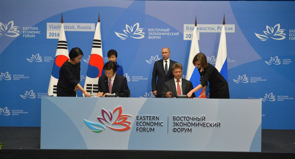 September 3, 2016. Russian President Vladimir Putin and South Korean President Park Geun-hye, background, during the ceremony of signing joint documents following the Russian-South Korean talks as part of the Eastern Economic Forum. Foreground, second left: South Korean Minister of Foreign Affairs and Trade Yun Byung-se. Foreground, second right: Russian Minister of Transport Maxim Sokolov.