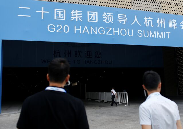 Security personnel patrol in front of the entrance of a conference centre, where the G20 summit is held, in Hangzhou, Zhejiang Province, China