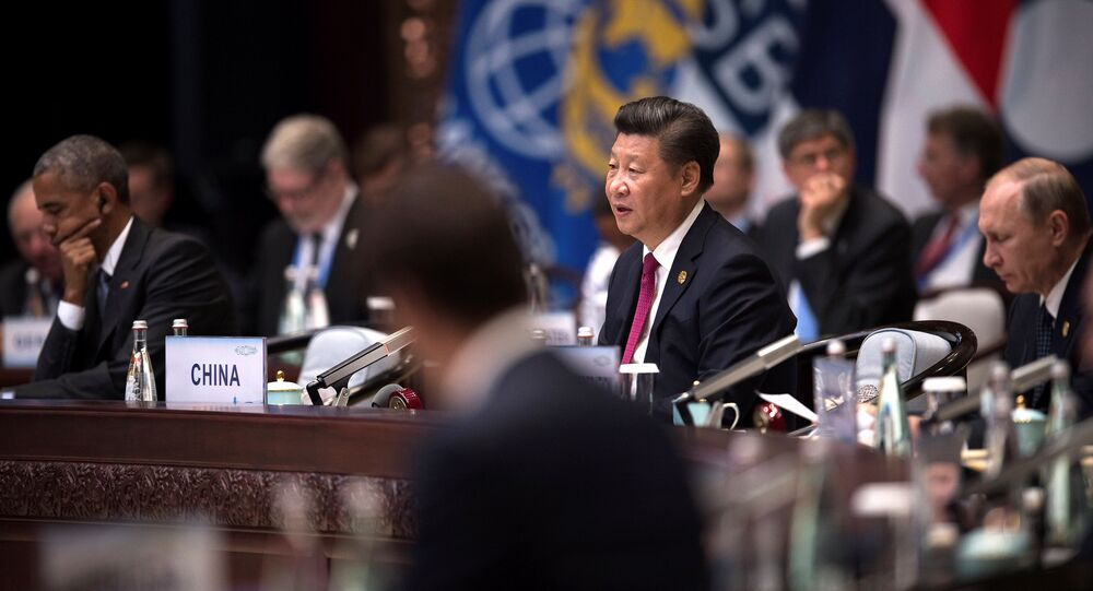 Chinese President Xi Jinping (C) makes a speech during the opening ceremony of the G20 Leaders Summit as US President Barack Obama (L) and Russia's President Vladimir Putin (R) listen in Hangzhou, Zhejiang province, China, September 4, 2016.