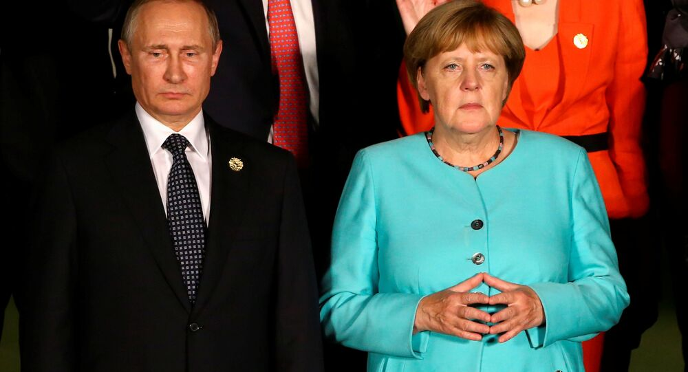 Russian President Vladimir Putin and German Chancellor Angela Merkel attend the G20 Summit in Hangzhou, Zhejiang province, China