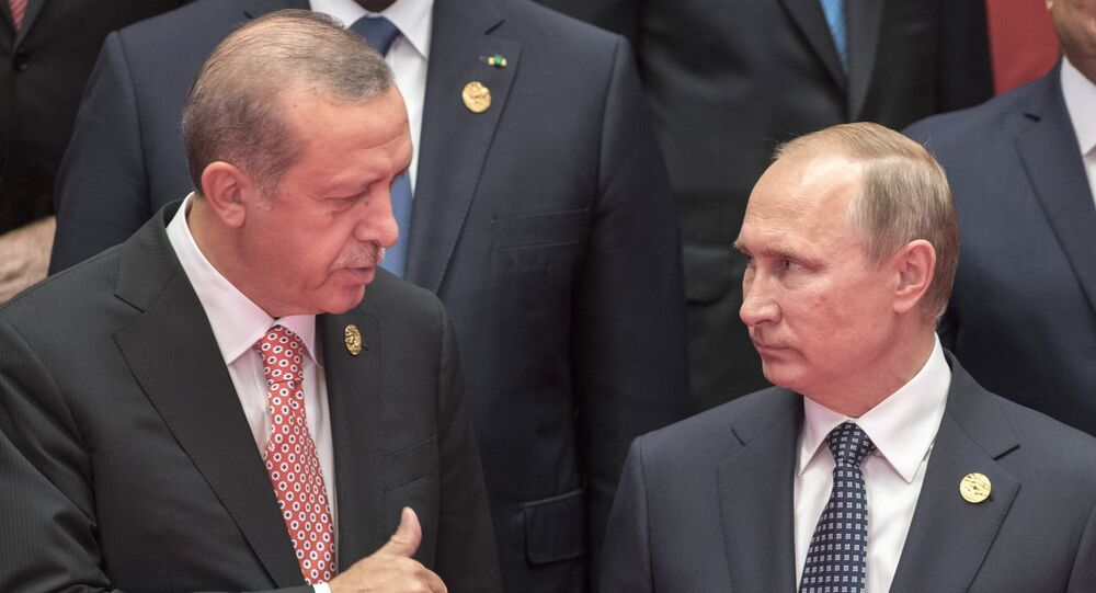 Russian President Vladimir Putin, right, and Turkish President Recep Erdogan during the group photo session of the heads of G20 nations, invitees and international organizations in Hangzhou