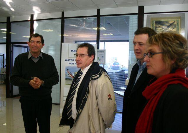 European Parliament Member Robert Rochefort, in the center