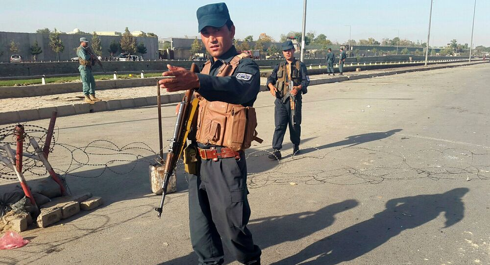 Afghan policemen stand guard at the site of a blast in Kabul, Afghanistan September 5, 2016