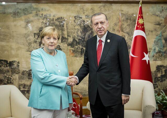 German Chancellor Angela Merkel meets Turkish President Tayyip Erdogan during the G20 Summit in Hangzhou, Zhejiang province, China, September 4, 2016