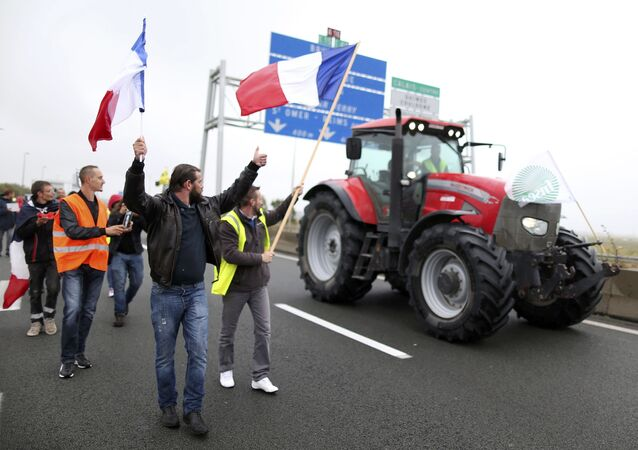 Harbor workers, truck drivers, farmers, storekeepers and residents attend a protest demonstration on the A16 motorway against the migrant situation in Calais, France, September 5, 2016.