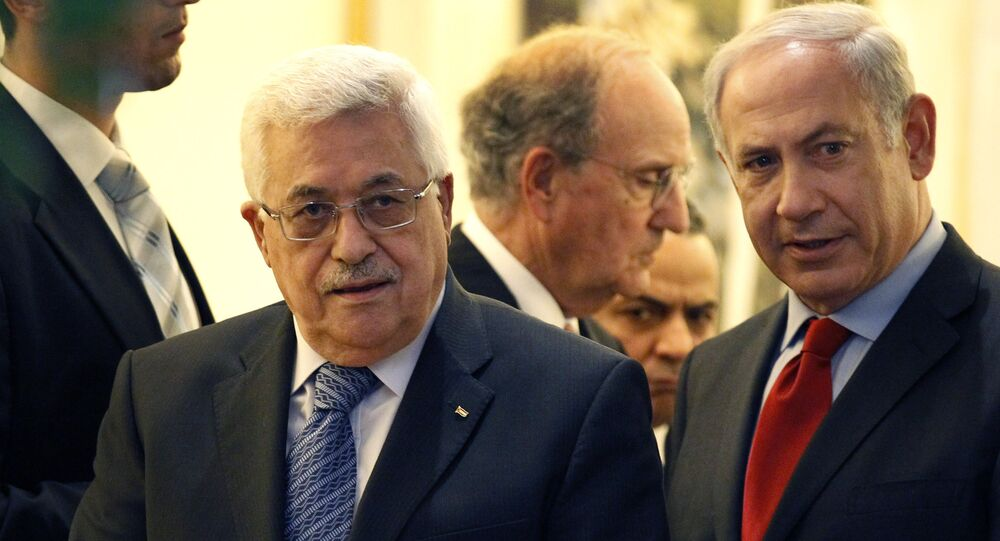 Palestinian president Mahmoud Abbas, left, walks with Israeli Prime Minister Benjamin Netanyahu, right, with Special Middle East Peace Envoy, former Sen. George Mitchell, behind center, at his residence in Jerusalem, Israel Wednesday, Sept. 15, 2010